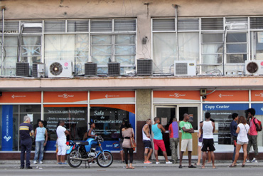 Cubans in line to check their e-mail or use the Internet.