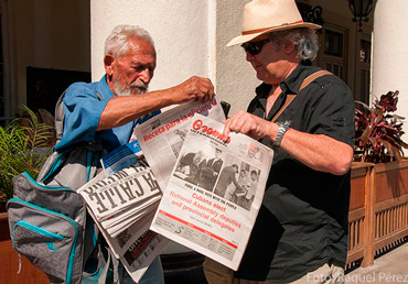 The elderly begin to stand in line in the early morning to buy newspapers they later resell for a few extra cents.