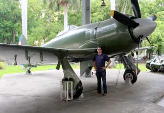 The author next to the plane piloted by his father, on display at Havana's Revolution Museum.