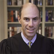 District Judge James Boasberg rejected that Gross's suit in 2013.