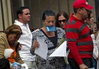 Cubans lining up in Havana to have their travel documents processed.