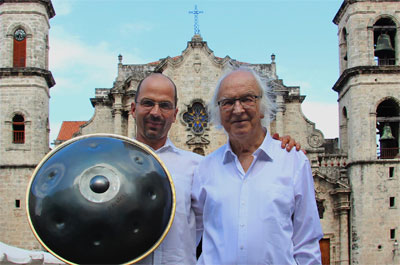 """Ananda Stephan and his father Joseph Röösli.  The Swiss percussion instrument is the """"hang"""""""