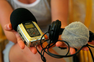 Digital recorder, headphones and a microphone.