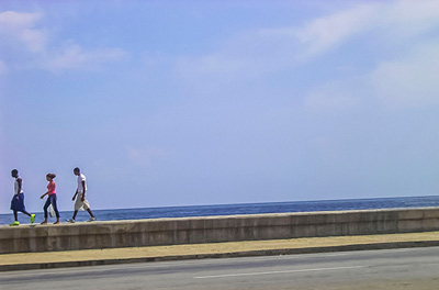 Photo on the Havana Malecon Seawall by Yamila Mayet