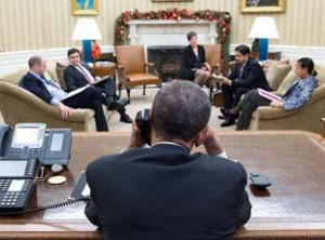 President Barack Obama in the Oval Office, during a historical phone conversation with Raul Castro on December 16.