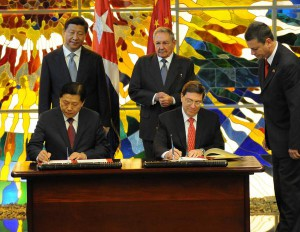 Xi Jinping and Raul Castro oversee the signing of new agreements in July 2014.