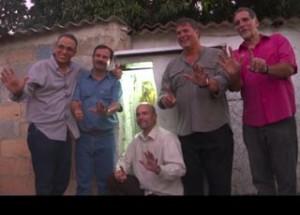 The Cuban Five in front of a modest shrine to Saint Lazarus in El Romerillo, Havana