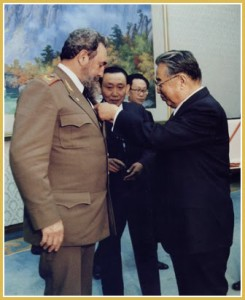 Kim Il Sung pins medal on Fidel during his visit to Pyongyang in March 1986.