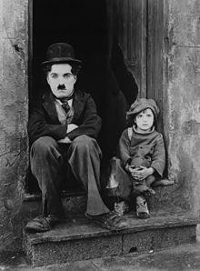 Chaplin and Jackie Coogan in The Kid  (1921).