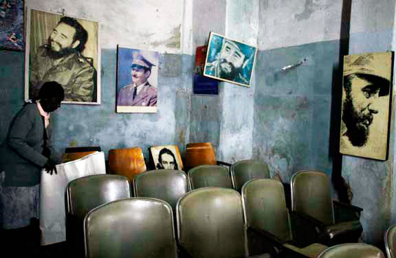 Pictures of Fidel and Raul Castro in a rundown Havana locale.