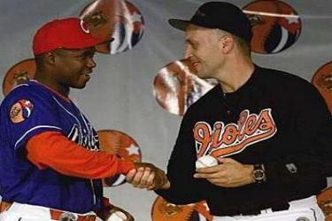 Omar Linares and Carl Ripken when the Orioles played in Cuba back in 1999.