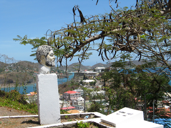 Bust of Maurice Bishop in Upper Cemetery; Fort George, where he was killed, in the background.  Photo: Shalini Puri