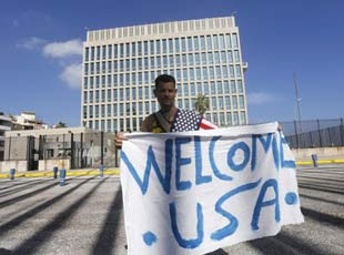 A Cuban welcomes the reopening of the US Embassy in Havana on July 20, 2015.