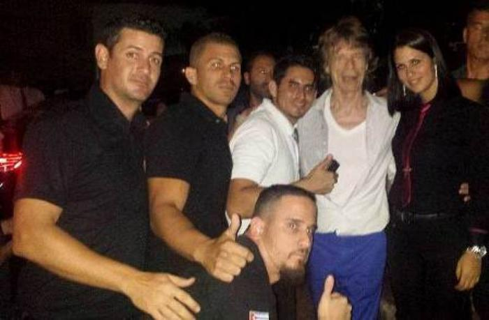 Mick Jagger with workers at the Shangri La bar and restaurant in Havana.