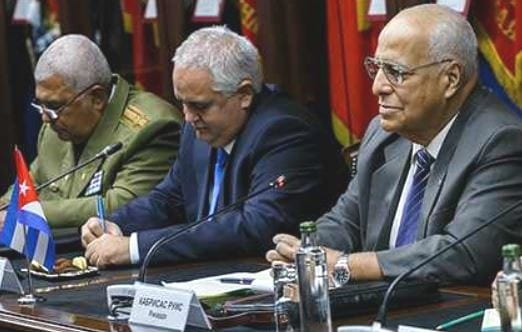 The Cuban side included, from right, Ricardo Cabrisas; Ambassador Emilio Losada and an unidentified Cuban officer.