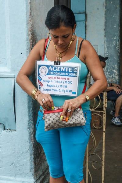 Seller of phone cards. Photo: Juan Suarez