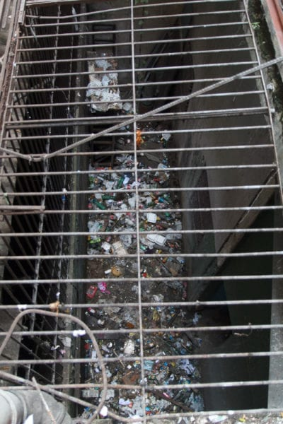 The garbage visible from a higher floor of the building.