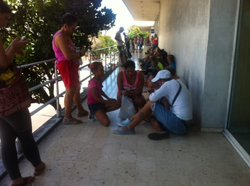 People at one of the Wi-Fi points on La Rampa.