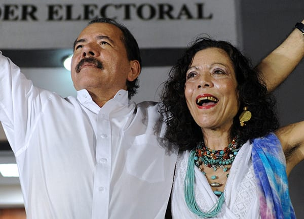 Nicaraguan President Daniel Ortega (L) celebrates with First Lady Rosario Murillo after receiving the credentials in Managua on January 9, 2012, a day before his re-inauguration. AFP PHOTO/Rodrigo ARANGUA (Photo credit should read RODRIGO ARANGUA/AFP/Getty Images)