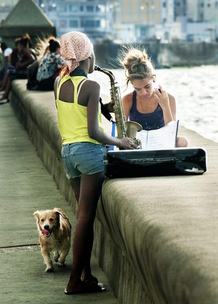 Music students on Havana's Malecon seawall. Photo: Ilia Khodos