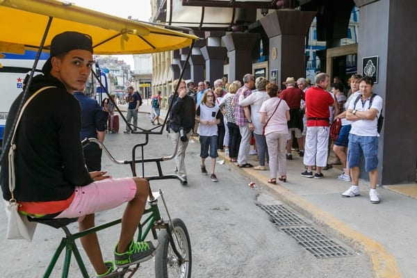 Bicycle taxi at the entrance to a hotel in Havana. Photo: Juan Suarez