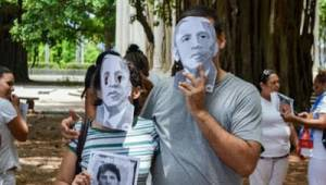 Activists brought masks of Obama to a Sunday march