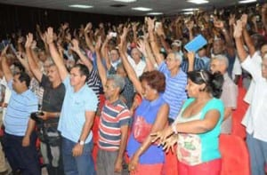 Plurality with a show of hands: members in Santiago elect Fidel and Raúl Castro as delegates at the VII Communist Party Congress.