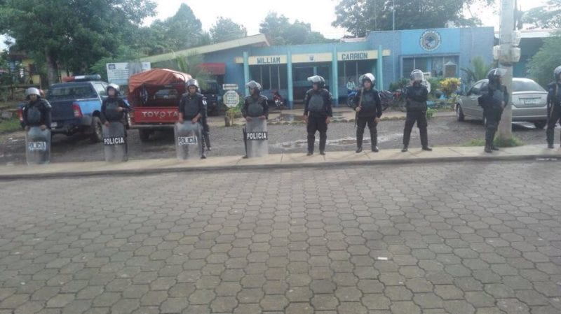 Riot police surrounding the police station in New Guinea.