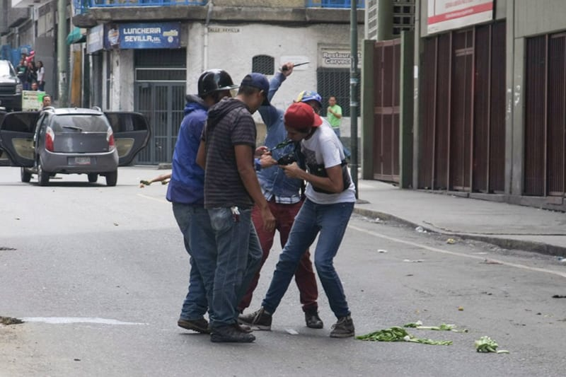 Journalists being attacked in downtown Caracas.