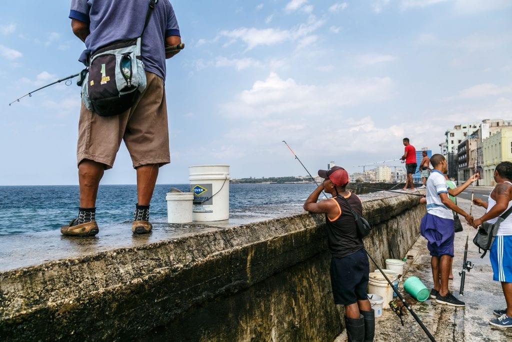 Fishing on the Malecon seawall. Photo: Juan Suarez