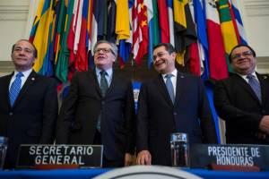 OAS Secretary General Luis Almagro and the President of Honduras.