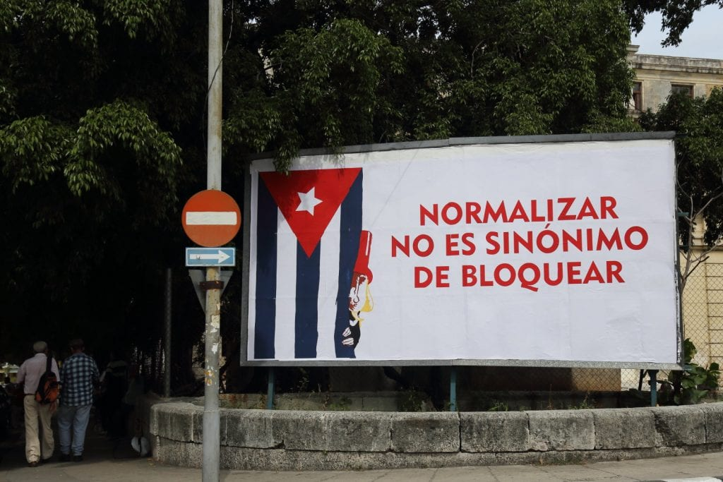 The Cuban government was highly critical of Obama's moves towards normalization considering them not enough. The sign reads: Normalization is not synonimous for blockading.