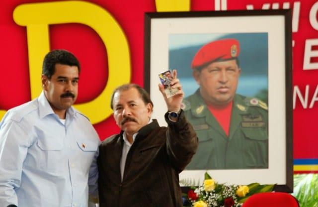 Nicolas Maduro, Daniel Ortega and the image of Hugo Chavez.