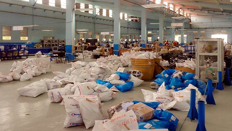 Packages and other mail at a warehouse of Correos de Cuba.