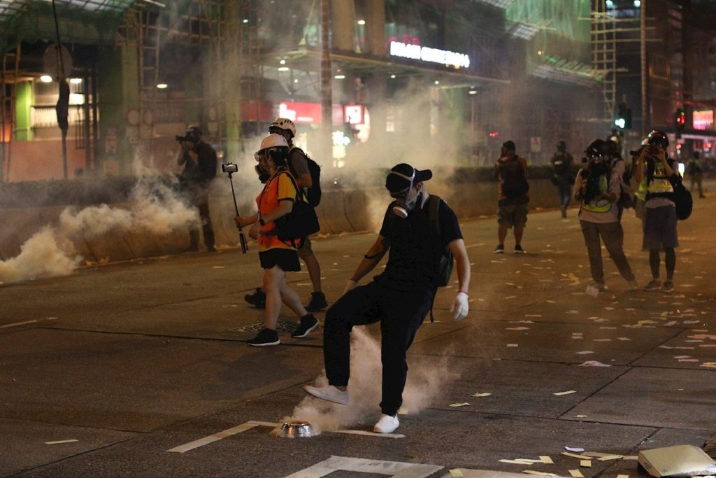 Hong Kong riot police beat protesters at anti-surveillance rally